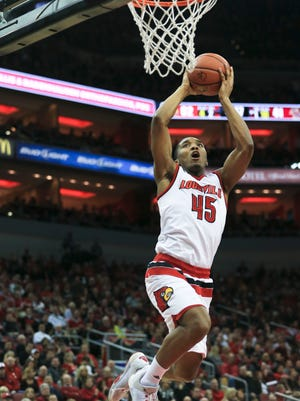 "Louisville's Donovan Mitchell goes for the slam dunk in the Cards 79-47 win Saturday. ""We have some classy fans,"" said Trey Lewis after the show of support Saturday. ""They're hurting. Every game is going to be emotional now."" Feb. 6, 2016"