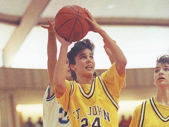 St. John Vianney's Audrey Gomez drives to the basket