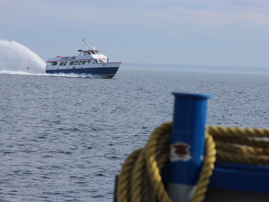A Shepler's boat travels between St. Ignace and Mackinac