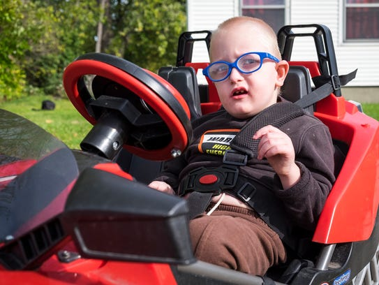 Isaac Vancamp, 4, in a model of a Polaris Slingshot