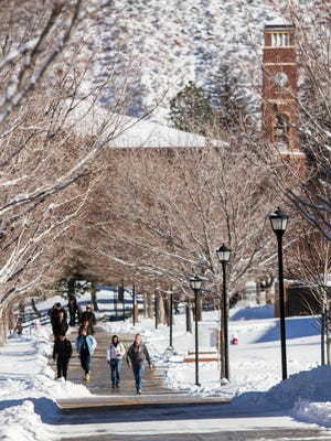 Students walk across the campus of Southern Utah University after yesterday's snow storm, Friday, Jan. 6, 2017.