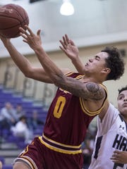 Tulare Union's Kazmeir Allen goes up for two points under pressure from Mission Oak's Terry Thomas in a East Yosemite League high school boys basketball game Thursday.