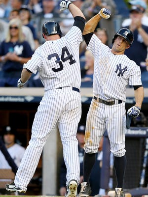 Yankees catcher Brian McCann (34) celebrates his two-run home run with teammate Brett Gardner in the eighth inning against the Pirates at Yankee Stadium on Saturday.