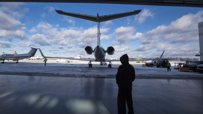 The cities of Burlington and South Burlington have reached an agreement regarding property taxes involving Burlington International Airport. Here, a jet is seen as it is towed out of a hanger at Heritage Aviation at the Burlington International Airport in South Burlington on Wednesday, January 13, 2016.