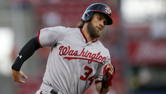 Washington Nationals right fielder Bryce Harper (34) rounds third base to score on a Washington Nationals third baseman Anthony Rendon (6) single to center field in the top of the first inning during the game between the Cincinnati Reds and the Washington Nationals at Great American Ball Park on July 14, 2017.