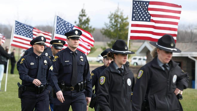 Peace officers and first responders arrive Friday, April 1, 2016 during the funeral for officer Carlos Puente-Morales at at the Iowa Veterans Cemetery in Adel.
