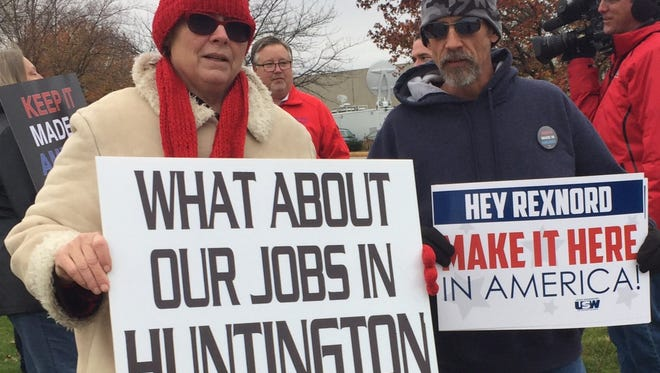 Susan Cooper, a Carrier employee from Huntington, and Gary Canter, a Rexnord employee in Indianapolis, face layoffs in the coming months. They greeted President-elect Donald Trump's arrival Thursday with messages about their own plights.