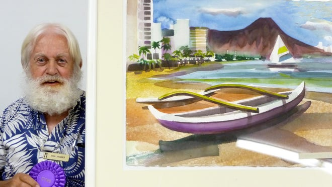 """Ron Hanner is shown when he was named Coachella Valley Watercolor Society's Painter of the Year, with his painting """"Waikiki Beach."""""""