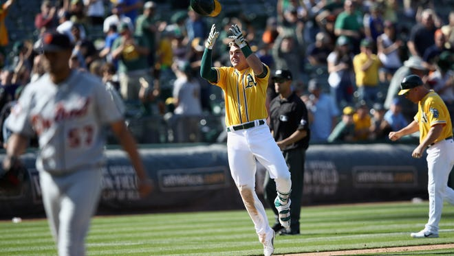 A's third baseman Ryon Healy reacts as he runs to home plate after he hit a walk-off home run in the ninth inning of the Tigers' 8-6 loss Sunday in Oakland, Calif.