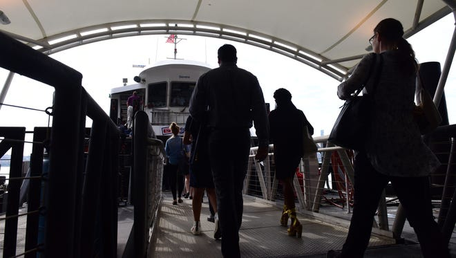 "Commuters board a special ferry to 39th Street at the Hoboken Terminal on the first morning of the ""Summer of Hell"" as track work begins at Penn Station."