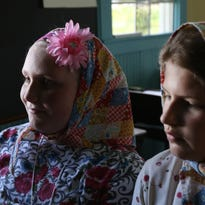 Kaylee Theisen (L), and MicKayla Andrews, both fourth graders at Alexander Middle School in Nekoosa, relax inside the Scranton School, a historicaly preserved one-room school from the 1940's, at the Pittsville Area Historical Society May 25, 2016.