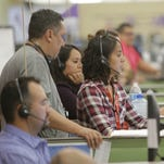 Verizon Wireless customer service representatives take calls in 2015 at the company's East El Paso call center. Workers in call centers are part of the Office and Administrative Support occupation group, which had the largest employment share in El Paso in 2015 and had an average hourly wage 19 percent below the national average, a new federal report shows.