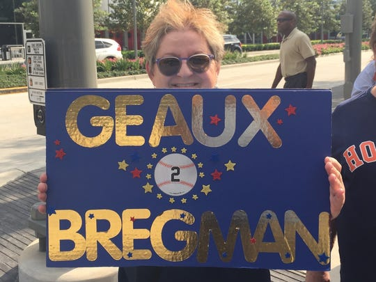 A woman from Lafayette cheered on former LSU star Alex Bregman and the Houston Astros at Game 1 of the American League Championship Series in Houston on Friday.