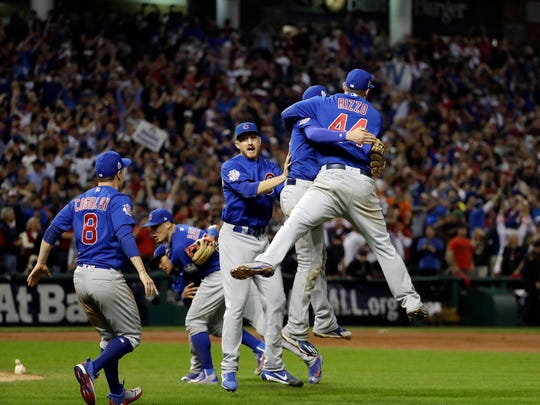 The Chicago Cubs celebrate after Game 7 of the Major League Baseball World Series against the Cleveland Indians Thursday, Nov. 3, 2016, in Cleveland. The Cubs won 8-7 in 10 innings to win the series 4-3. (AP Photo/David J. Phillip)