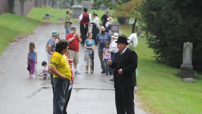 Guests hear from re-enactor Eric Burkhardt, right, during Tales From the Departed. A special bicentennial event will take place this Saturday at Wayne County Historical Museum instead of the cemetery.