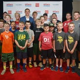 Jordy Nelson takes a photo with the Sanford Power Riggs Premier Football Academy before the Argus Leader Sports Awards Wednesday, May 16, at the Sanford Pentagon.