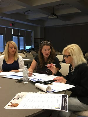 Nancy Insco (right), founder of The Institute for Reform and Solutions reviews issues with Tera Warf from Valley Community Services Board and Nikki Sheets Narduzzi from Cannabis Commonwealth that will be addressed at Community Criminal Justice Days on Oct. 18-19 at Blue Ridge Community College in Weyers Cave. The event is open to the public.