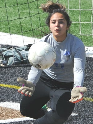 San Angelo Lake View goalie Jaqui Ortiz makes a stop in the second half against Cooper. The Maidens beat Cooper 2-0 in the District 4-5A soccer game Tuesday, March 13, 2018 at Shotwell Stadium.