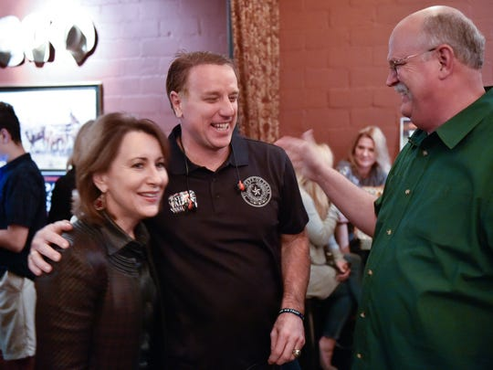 Collin County businessman Pat Fallon, 50, middle, is