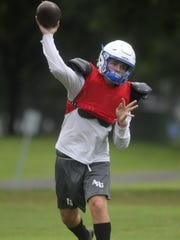Trey Fisher and the Godby Cougars' football team practices