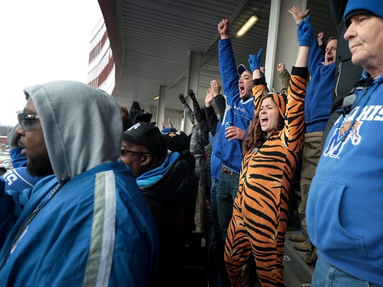 Univewrsity of Memphis fan Lacy Ritter celebrates a tiger touchdown during the 59th annual Liberty bowl in Memphis Saturday.