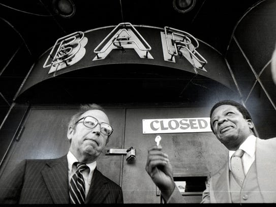 Wayne County Prosecutor William Cahalan and Detroit Police Chief William Hart padlock the Willis Show Bar in this Detroit Free Press photo from October 1978.