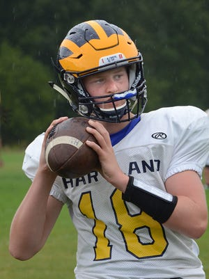Hartland freshman quarterback Zach Trainor was 18-for-21 for 157 yards and two touchdowns in his high school debut at Westland John Glenn.