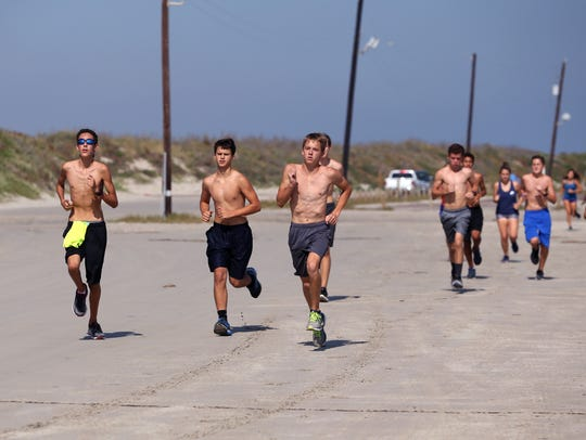 Members of the Port Aransas Cross Country team run