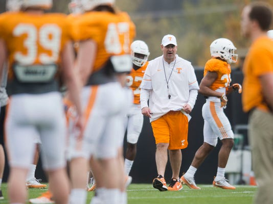In this March 27, 2018 photo, Tennessee head coach Jeremy Pruitt walks on the field during an NCAA college football practice in Knoxville, Tenn. Tennessee's first spring under new coach Pruitt is notable in part for what isn't being said. Pruitt rarely, if ever, mentions a single player by name in media sessions as he evaluates just what he has on his roster and tries to determine who can contribute in the fall. (Caitie McMekin/Knoxville News Sentinel via AP)