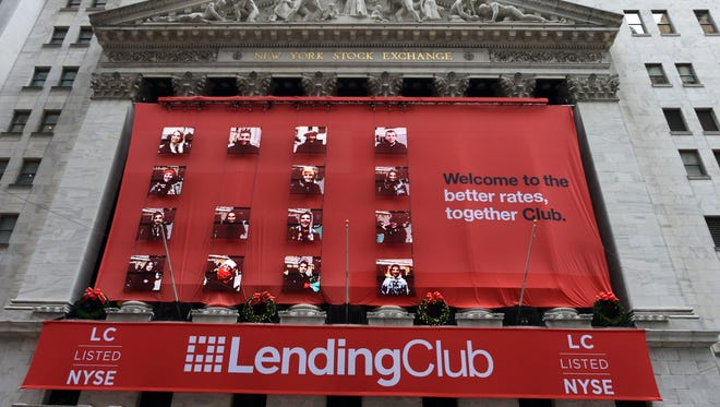 Lending Club banners hang on the facade of the New York Stock Exchange for its IPO December 11, 2014 in New York.