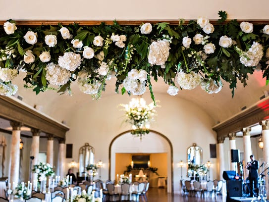 Greenery is used as decor at a wedding.