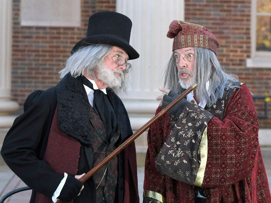 Dickens of a Christmas characters Scrooge, played by Mark Price, and Fagin, played by John Fraser, act out their characters on the steps of the old courthouse in downtown Franklin. This is the 29th year for Fraser and 12th year for Price playing their characters at Dickens of a Christmas.