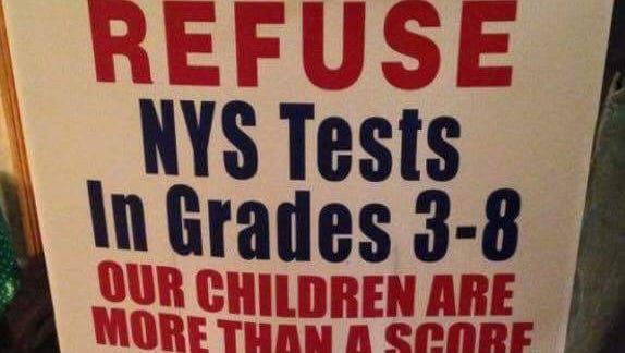 A sign encouraging parents to opt out of the state's grade 3-8 standardized tests.