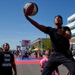 Damion Farrior, 17, of Port Huron, makes a shot while playing with his team BRG Goonsquad during the Gus Macker basketball tournament Saturday, May 23, 2015 in Port Huron.