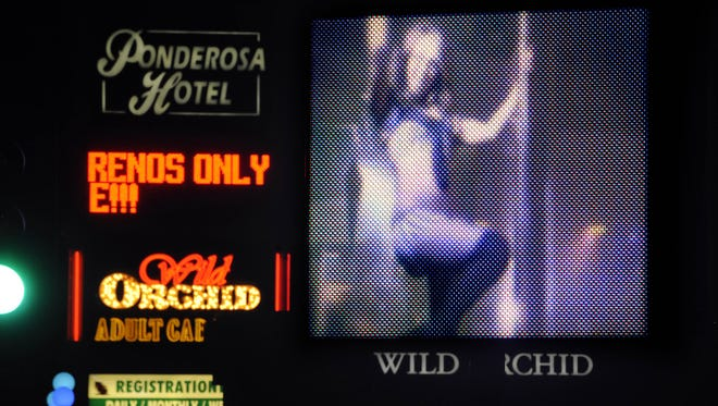 The video sign outside the Wild Orchid gentleman's club on Monday, May 2, 2011.