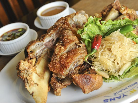 A house favorite, crispy pata, prepared at Ben n' Yan's restaurant. Crispy pata is deep-fried pork knuckles.