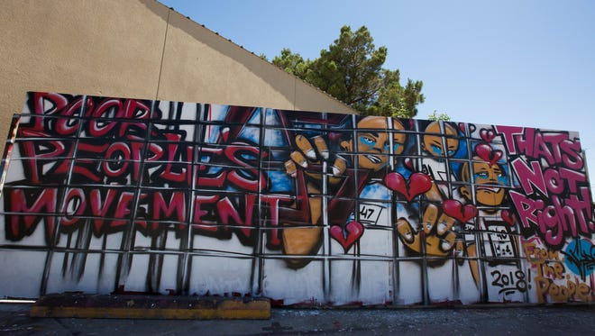 The Poor People's Movement mural on the side of the Barricade Culture Shop on South Solano Street, Wednesday June 20, 2018.