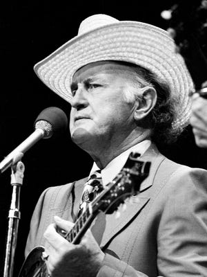 Bill Monroe performs for the weather-dampened crowd during the Opry Spectacular show at the Grand Ole Opry House on Oct. 16, 1975.