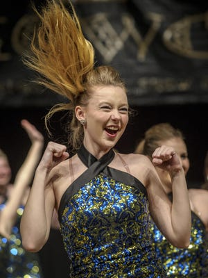 Rachel Blakesley gives great facial expressions during Vocal Gold's performance at the Ram Showcase.