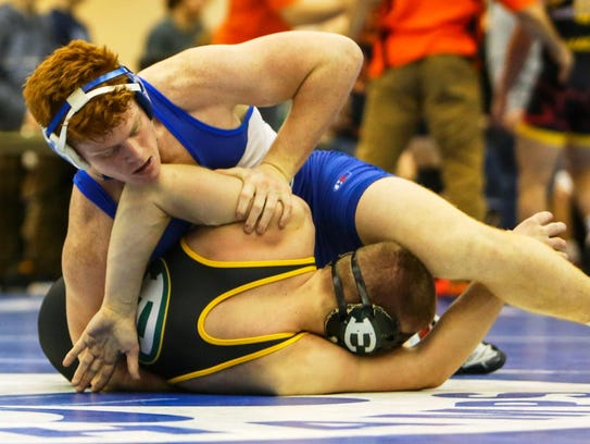 Catholic Central junior Tyler Morland (top) won all