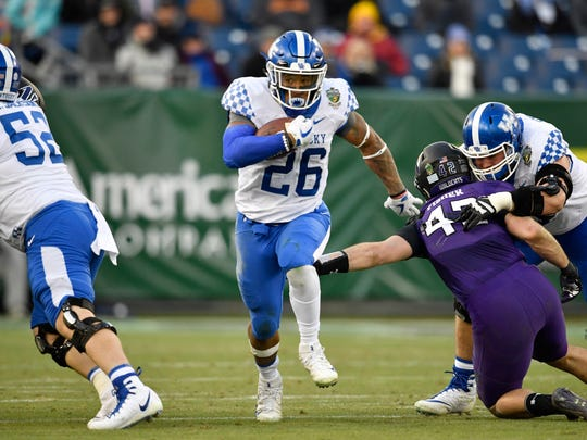 Kentucky running back Benny Snell Jr. (26) gains yards during the first half of the Music City Bowl at Nissan Stadium in Nashville, Tenn., Friday, Dec. 29, 2017.