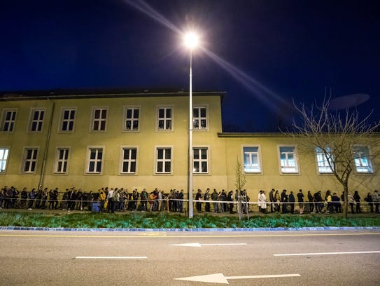 People line up to vote in the general election at a