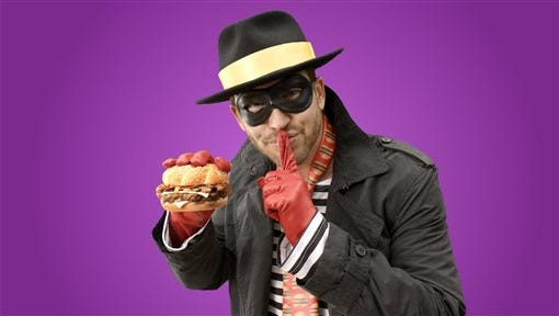 In this undated product image provided by McDonald's one of the McDonald's mascots the Hamburglar poses for a photo. The company is bringing the burger thief back to its advertising after a 13-year absence. On Wednesday, May 6, 2015, McDonald's Corp. tweeted a 30-second ad featuring the Hamburglar, his face unseen, flipping burgers in a suburban backyard with his wife and son. (McDonald's via AP)