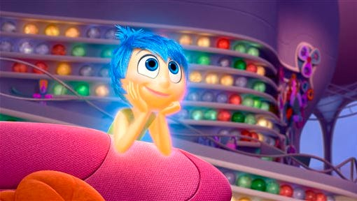 """In this image released by Disney-Pixar, the character Joy, voiced by Amy Poehler, appears in a scene from """"Inside Out."""" The movie releases in theaters on June 19, 2015."""