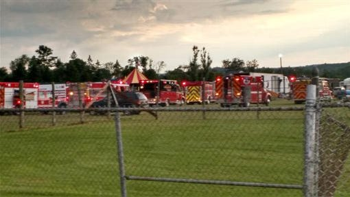 Officers surround the scene of a tent collapse in Lancaster, N.H., Monday, Aug. 3, 2015. Authorities say the circus tent collapsed when a severe storm raked the New Hampshire fairground.