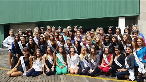 The 2016 Miss America pageant contestants pose for a photo on the Boardwalk in Atlantic City, N.J., Friday, Sept. 11, 2015, after rehearsals. Winners in the swimsuit and talent preliminary competitions accrue points that boost their scores heading into Sunday night's nationally televised finale.