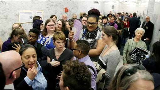 People pack a hallway outside a Washington Senate hearing room, Wednesday, Jan. 27, 2016, at the Capitol in Olympia, Wash., as they wait to listen to public testimony regarding a bill that would eliminate Washington's new rule allowing transgender people use gender-segregated bathrooms and locker rooms in public buildings consistent with their gender identity. (AP Photo/Ted S. Warren)