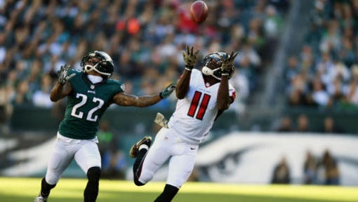 Eagles cornerback Nolan Carroll can't prevent Falcons wide receiver Julio Jones from catching a pass in the second quarter last Sunday during the Eagles' 24-15 win.
