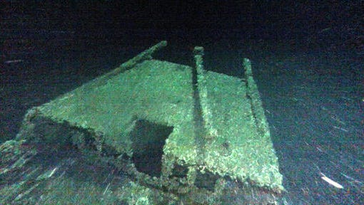 """In this undated photo provided by Roger Pawlowski, the cabin and tiller of the """"Black Duck"""" is shown in 350 feet of water off Oswego, N.Y. Underwater explorers say they've found the 144-year-old Lake Ontario shipwreck of the rare sailing vessel that typically wasn't used on the Great Lakes. Underwater explorer Jim Kennard says the Black Duck is believed to be the only fully intact scow-sloop to exist in the Great Lakes."""