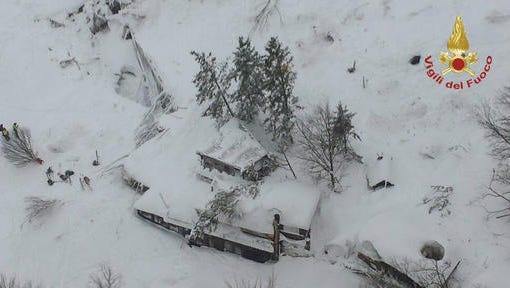 An aerial view of the Rigopiano Hotel hit by an avalanche in Farindola, Italy, early Thursday, Jan. 19, 2017. A hotel in the mountainous region hit again by quakes has been covered by an avalanche, with reports of dead. Italian media say the avalanche covered the three-story hotel in the central region of Abruzzo, on Wednesday evening.